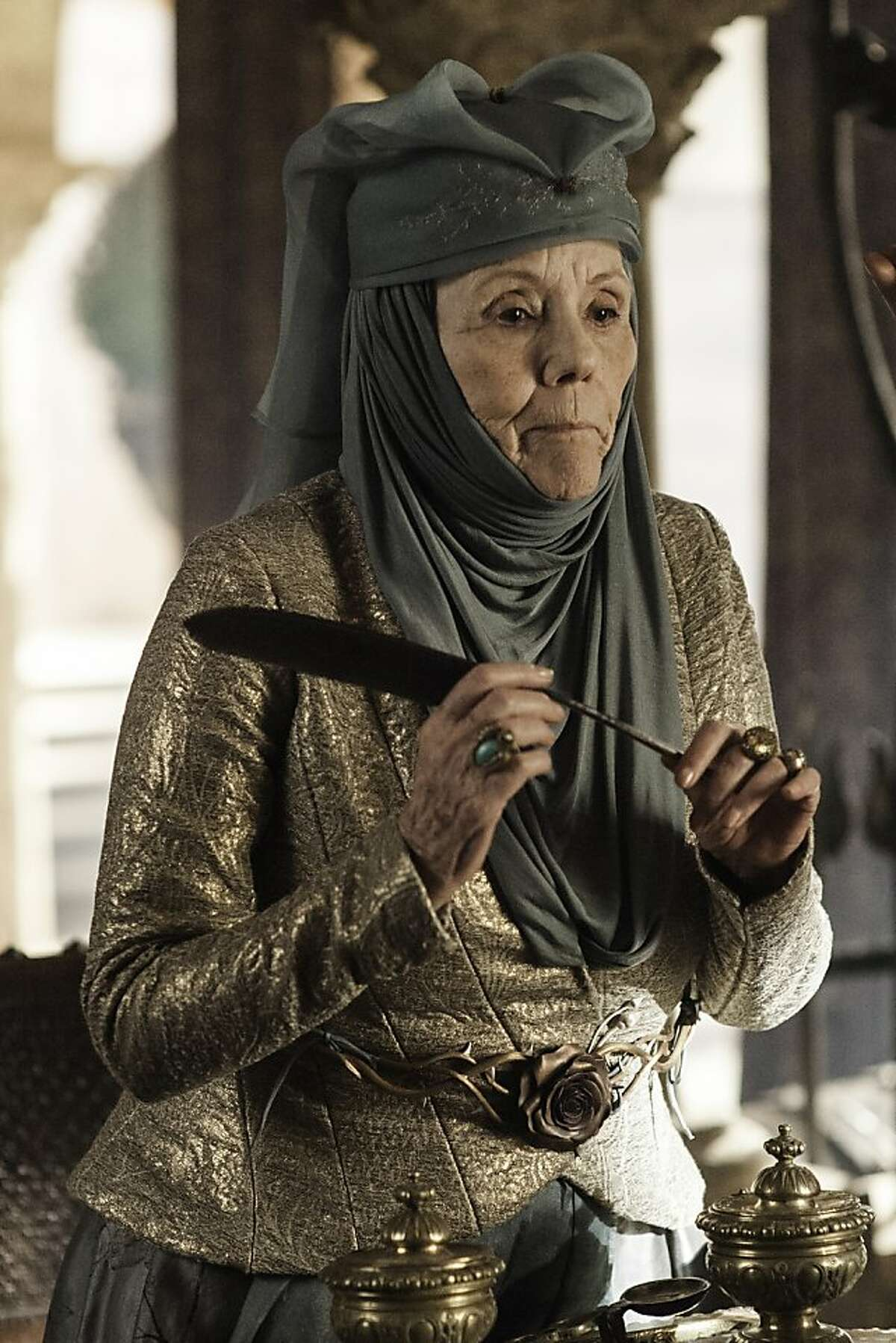 """Diana Rigg joins the cast of HBO's """"Game of Thrones,"""" returning for its third season Sunday. She plays Lady Olenna Tyrell"""
