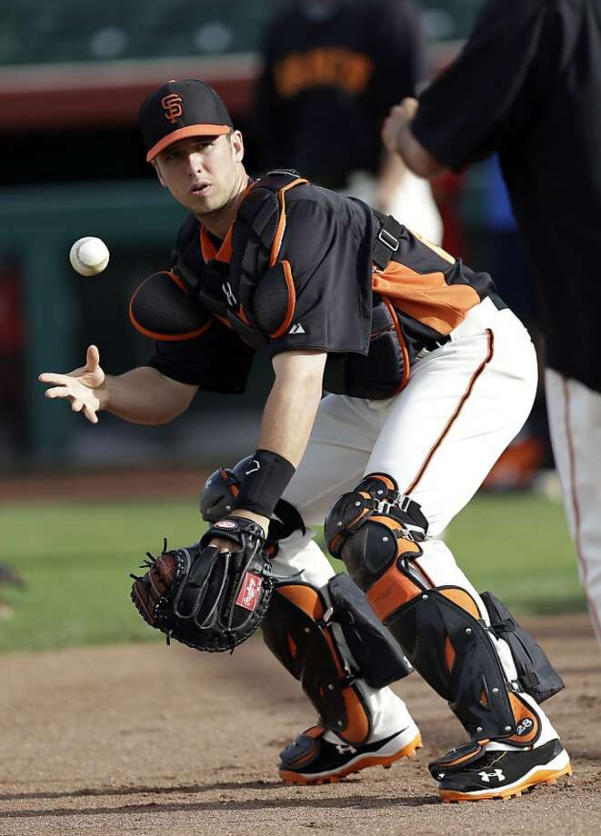 Buster Posey donned his catching gear in 114 games last season and wore a first baseman's glove in 29. Photo: Marcio Jose Sanchez, Associated Press