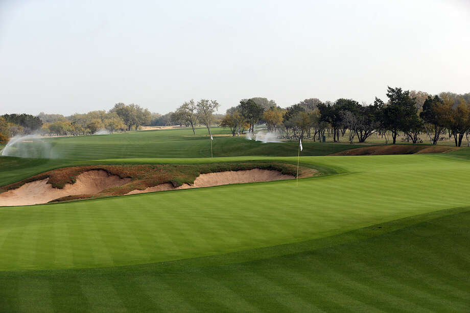 The second cut of grass around the greens at the AT&T Oaks Course — Nos. 2 (front) and 7 shown here — will be thicker this year in an effort to reduce the runoff of some wayward approach shots. Photo: Photos By Jerry Lara / San Antonio Express-News
