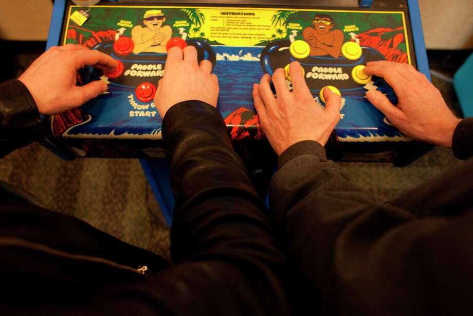 Attendees to the 27th annual Game Developers Conference, held at the Moscone Center in San Francisco, check out the vintage game exhibits featuring playable versions of early games on March 26th 2013. Photo: Sam Wolson, SFC / ONLINE_YES
