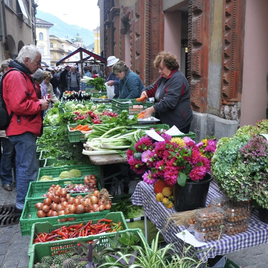 Medieval markets selling local produce and cheeses are a highlight of Treasures of Ticino, Switzerland, one of the inaugural travel packages of Whole Journeys.