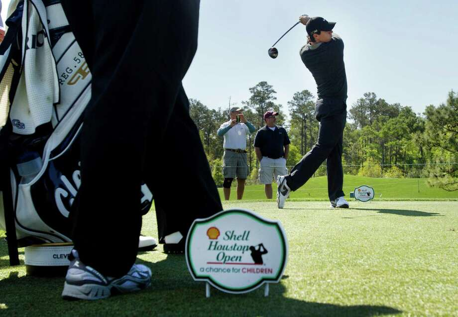 Rory McIlroy tees off on No. 4 during a practice round. Photo: Brett Coomer, Houston Chronicle / © 2013 Houston Chronicle