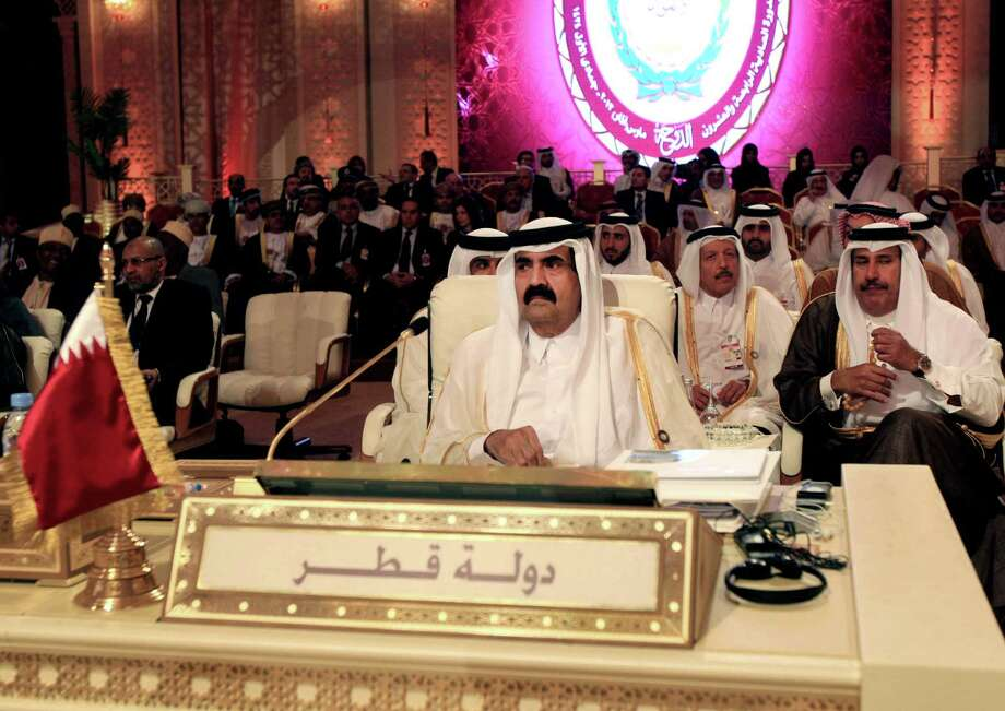 Emir of Qatar Sheikh Hamad Bin Khalifa Al Thani, center, delivered welcoming remarks at the opening session of the Arab League Summit on Tuesday. Photo: Ghiath Mohamad, STR / AP