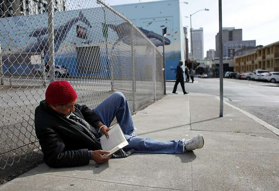"Jeffry Moore, 63, reclines on Olive Street in San Francisco's Tenderloin. At this stage, he is ""trying to deal with my homelessness with grace and dignity,"" he says. ""I'm not anticipating going anywhere with my life."" Photo: Lacy Atkins, The Chronicle"