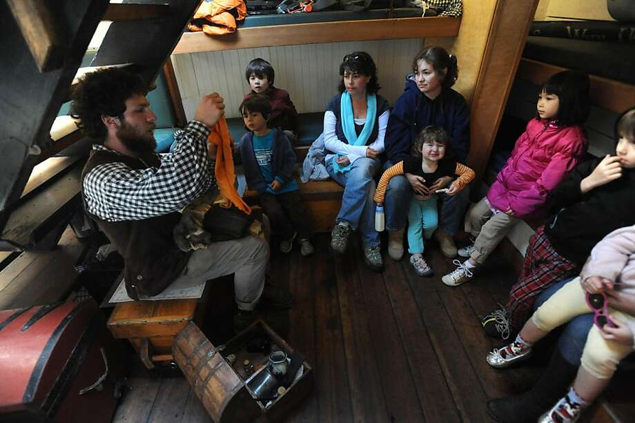Cullen Hedlesky shows off silk and other trade items on the tall ship Lady Washington that is docked near the Bay Model Visitors Center in Sausalito on March 26, 2013. The ship, along with the Hawaiian Cheiftain will be here until April 2, 2013. Photo: Susana Bates, Special To The Chronicle