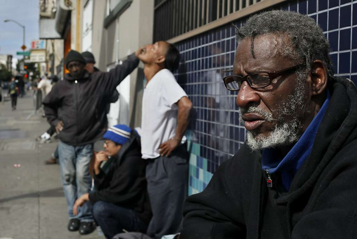 Clarence Perkins, 60, waits along Ellis Street with many other homeless people for the soup kitchens to open, Tuesday March 26, 2013, in San Francisco, Calif. Perkins has been homeless for 3 years.