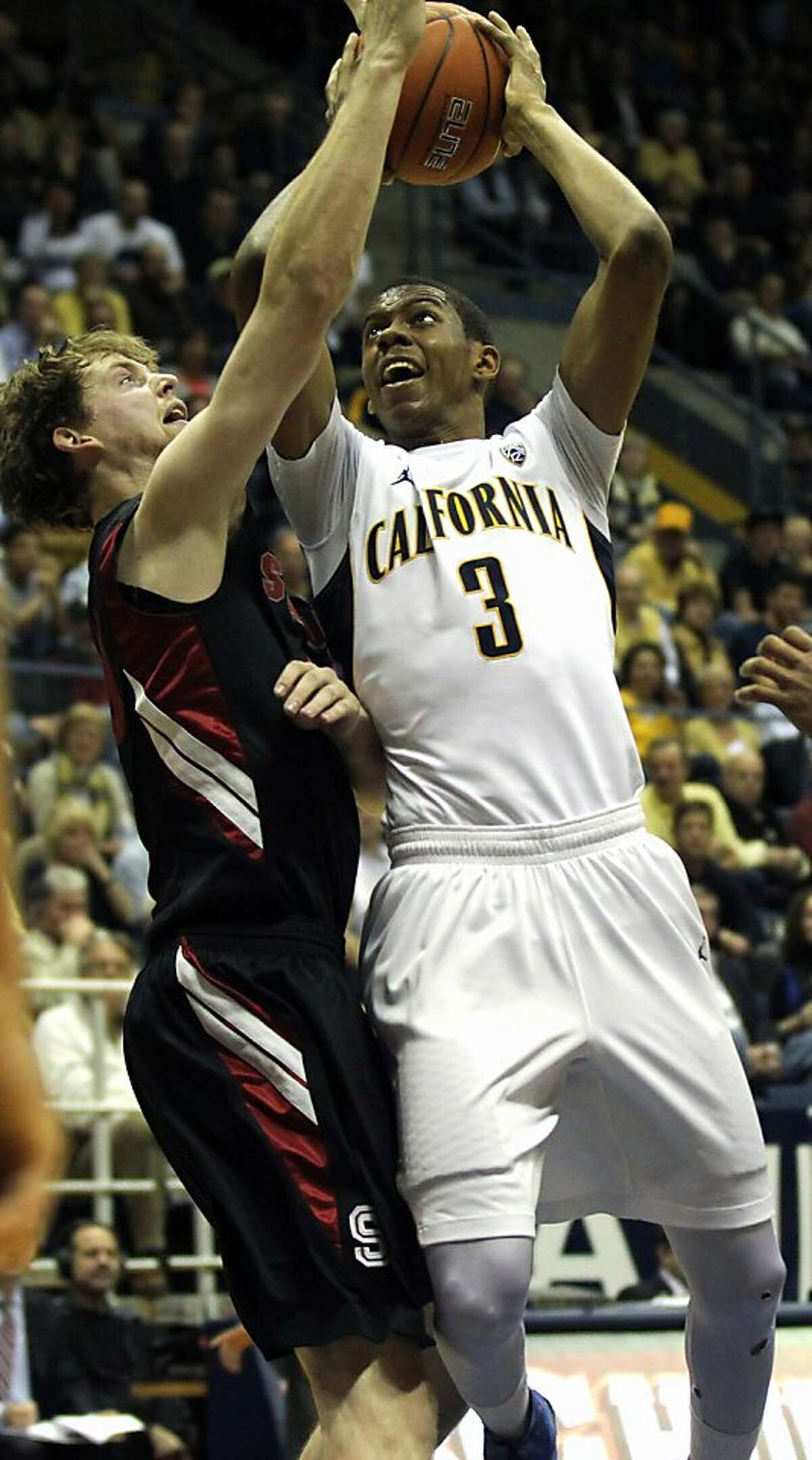 California guard Tyrone Wallace (3) drives to the basket in front of a Stanford defender in the first half of their NCAA basketball game Wednesday, March 6, 2013, in Berkeley, Calif.