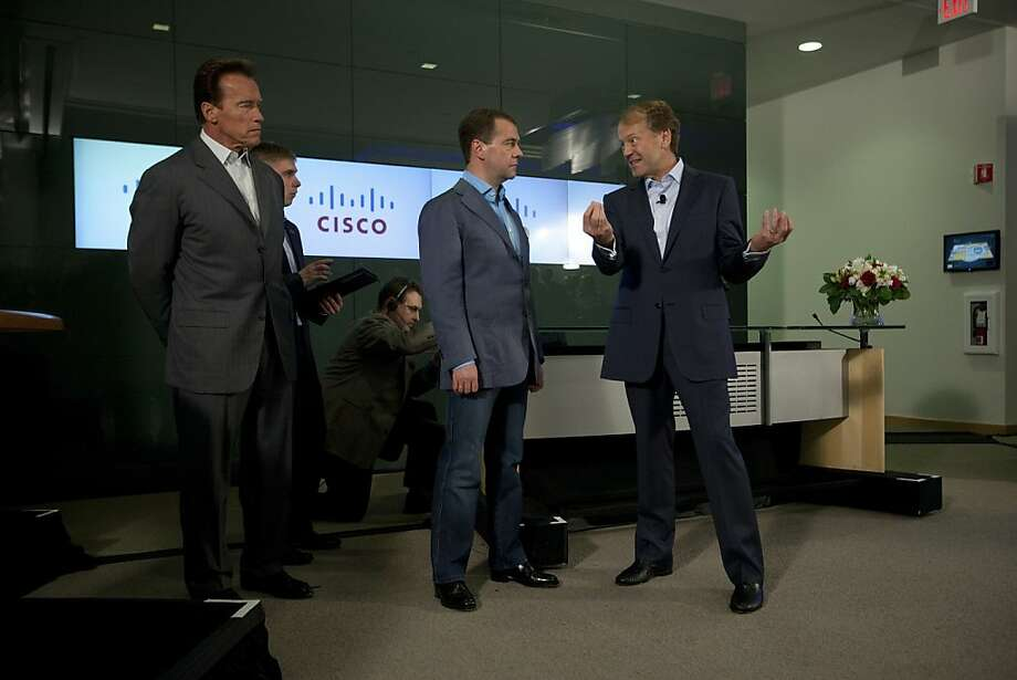 In 2010, then-Russian President Dmitry Medvedev (center) met with Cisco CEO John Chambers and then-Gov. Arnold Schwarzenegger in San Jose. Photo: David Paul Morris, Getty Images