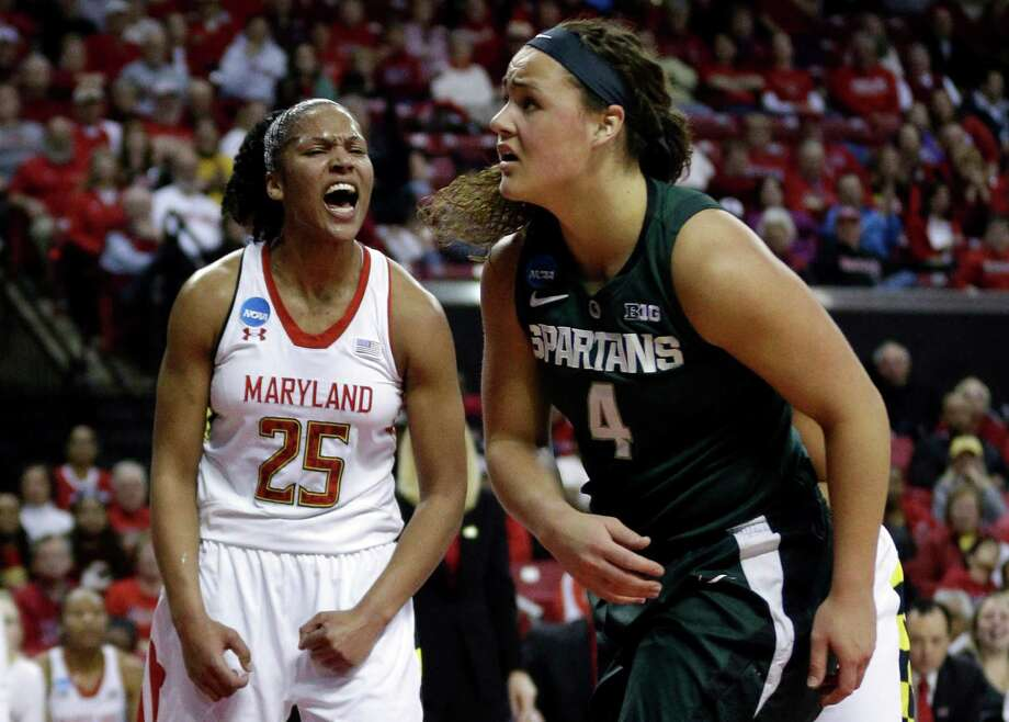 Maryland forward Alyssa Thomas, left, reacts after blocking a shot attempt by Michigan State center Jasmine Hines (4) during the first half of a second-round game in the women's NCAA college basketball tournament in College Park, Md., Monday, March 25, 2013. (AP Photo/Patrick Semansky) Photo: Patrick Semansky, Associated Press / AP