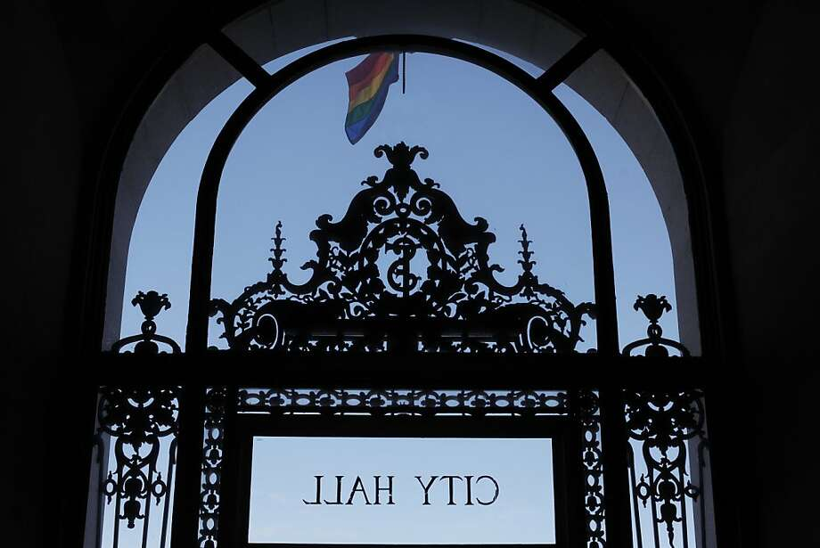 A rainbow flag waves from the front of City Hall on Tuesday, March 26. Supporters of same sex marriage gathered in front of the California Supreme Court Building during the Prop 8 hearings. Photo: James Tensuan, The Chronicle