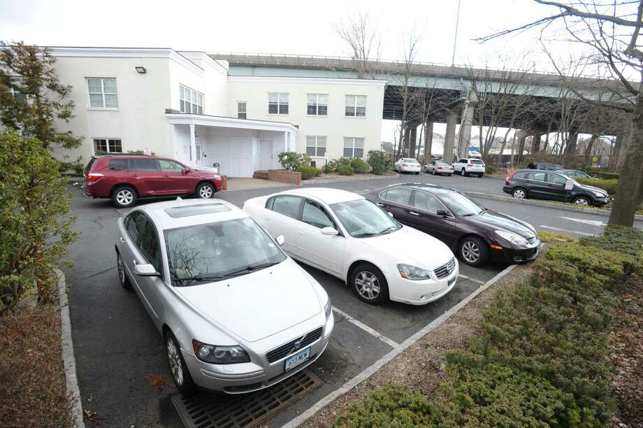 Crowded parking lot at 31 River Road in Cos Cob, Tuesday, March 26, 2013. The building is the site of one of the busiest medical practices in town and the owner has been trying to acquire space behind the building under the Mianus River Bridge from the state for over-flow parking. Photo: Bob Luckey / Greenwich Time