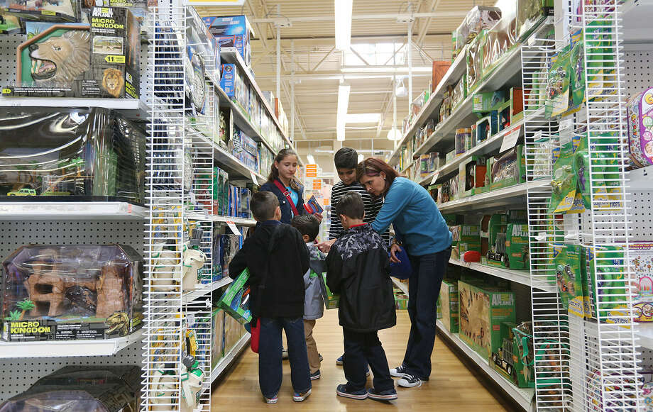 "Elsa Felix (right) leads her children and nephews as they shop at a Toys R Us on Loop 410. Felix, whose family is from San Luis Potosi, Mexico, said, ""Everything is so much cheaper here."" They also planned to visit SeaWorld, the River Walk and the zoo. Photo: Jerry Lara / San Antonio Express-News"