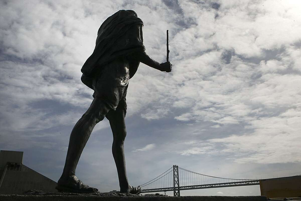 The bronze statue of Mohandas Gandhi behind the Ferry building in San Francisco, California, is missing his glasses and the bottom part of his staff on Tuesday, March 26, 2013.