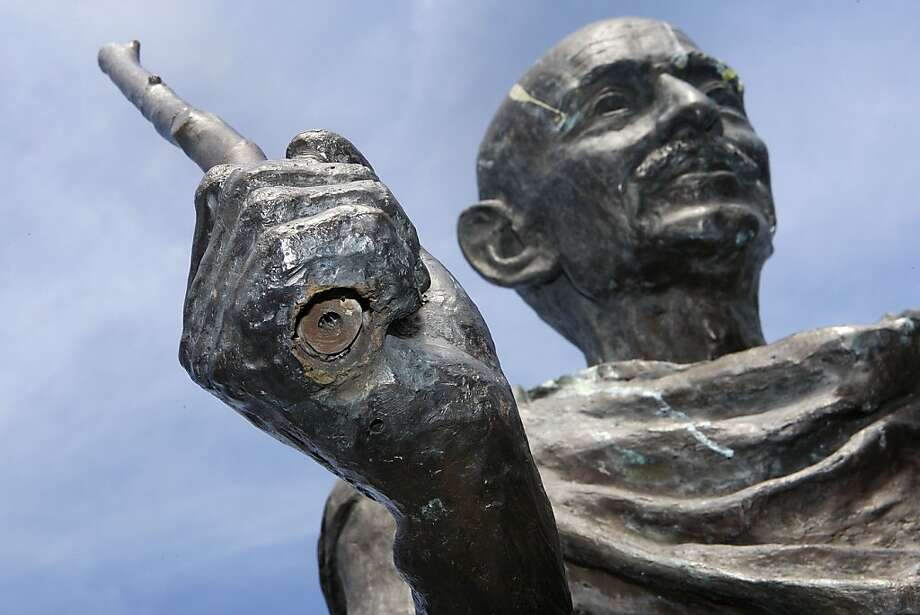 The statue of Mohandas Gandhi on the waterfront is missing its glasses, and its staff has been broken. Photo: Liz Hafalia, The Chronicle