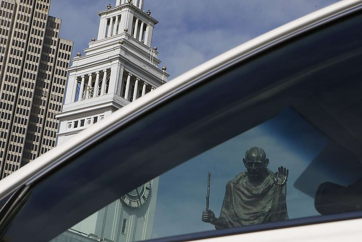 The bronze statue of Mohandas Gandhi behind the Ferry building in San Francisco, California, is missing his glasses and the bottom part of his staff on Tuesday, March 26, 2013. His glasses have been stolen 4 times within the last ten years. The San Francisco Arts Commission says it would cost about a thousand dollars to replace his glasses.