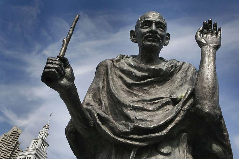 The bronze statue of Mohandas Gandhi behind the Ferry building in San Francisco, California, is missing his glasses and the bottom part of his staff on Tuesday, March 26, 2013.  His glasses have been stolen 4 times within the last ten years.  The San Francisco Arts Commission says it would cost about a thousand dollars to replace his glasses. Photo: Liz Hafalia, The Chronicle