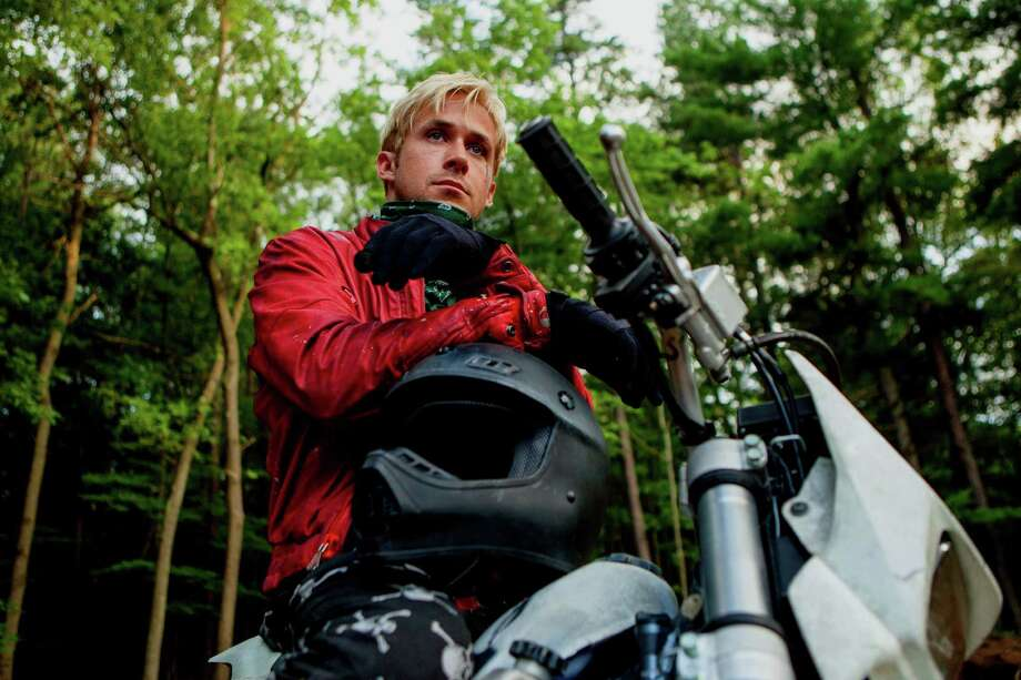 "Ryan Gosling, Bradley Cooper and Eva Mendes star in ""The Place Beyond the Pines,"" which was filmed in and around Schenectady. The movie hits theaters on Friday. Click here for listings.(AP Photo/Focus Features, Atsushi Nishijima) Photo: Atsushi Nishijima / Focus Features"