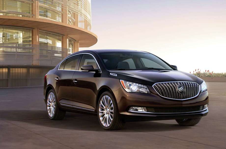 This photo provided by General Motors Co., shows the 2014 Buick LaCrosse 3.6L V6. GM is taking the latest step on its seemingly quixotic quest to revive the Buick brand in the U.S., rolling out refurbished versions of the midsize Regal and the larger LaCrosse in New York. (AP Photo/General Motors Co.) Photo: Uncredited, Associated Press / General Motors Co.