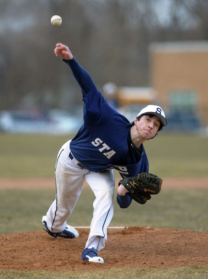 Staples' Robert Vallone pitches, during boys baseball action against Fairfield Warde in Fairfield, Conn. on Tuesday March 26, 2013. Photo: Christian Abraham / Connecticut Post