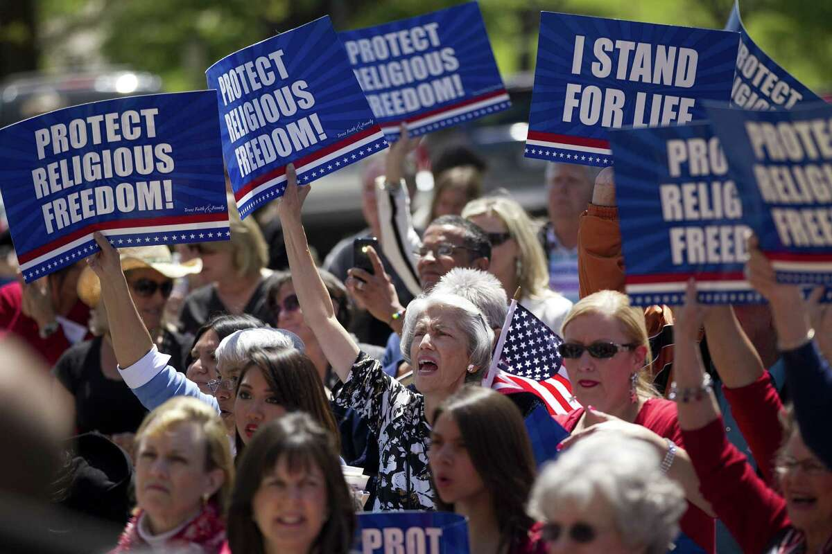 A crowd waves signs during the Texas Faith and Family Day rally at the Capitol in Austin, where Gov. Rick Perry and Lt. Gov. David Dewhurst spoke.