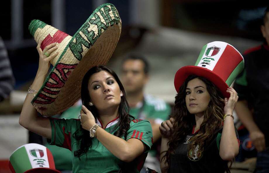 Mexican fans are seen before their FIFA World Cup Brazil 2014 qualifier football match between Mexico and US at Azteca stadium in Mexico City, on March 26, 2013.  AFP PHOTO/ Yuri CORTEZYURI CORTEZ/AFP/Getty Images Photo: YURI CORTEZ, AFP/Getty Images / YURI CORTEZ
