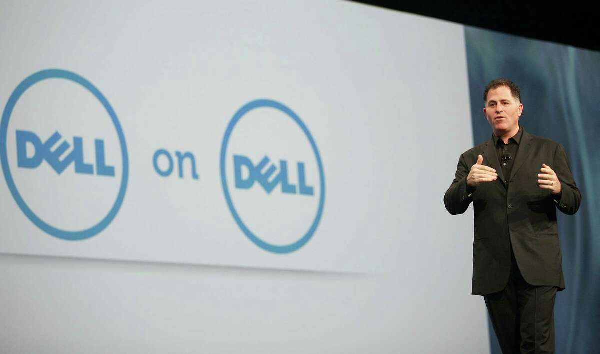 """(FILES)Dell Chairman and CEO Michael Dell delivers a keynote at the Moscone Center in San Francisco during the Oracle OpenWorld 2011 in this October 4, 2011 file photo in California. Dell's board of directors on March 6, 2013 defended a proposed $24.4 billion private equity buyout led by founder Michael Dell, but said it may continue looking at other offers past a March 22 deadline. A statement issued by the special committee of the board said the plan was adopted after """"a rigorous process, over a period of more than five months, to evaluate Dell's current risks, opportunities and strategic alternatives."""" """"As a result of that process, the special committee unanimously determined that the sale of the company would be the best alternative for stockholders, the statement said. AFP PHOTO / Kimihiro Hoshino KIMIHIRO HOSHINO/AFP/Getty Images"""