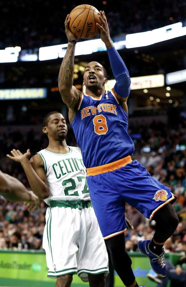 New York Knicks' J.R. Smith (8) drives past Boston Celtics' Jordan Crawford during the second quarter of an NBA basketball game in Boston, Tuesday, March 26, 2013. (AP Photo/Winslow Townson) Photo: Winslow Townson