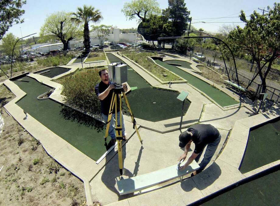 Randal Martin (left) and Cole Barton of Frontier Surveying Co. take laser readings at Cool Crest miniature golf course on Fredericksburg Road. New owners are revitalizing the facility. Photo: Billy Calzada / San Antonio Express-News