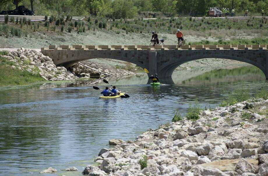 Kayakers and cyclists enjoy a newly completed stretch of Mission Reach at Padre Park. Photo: Darren Abate, For The San Antonio Express-News
