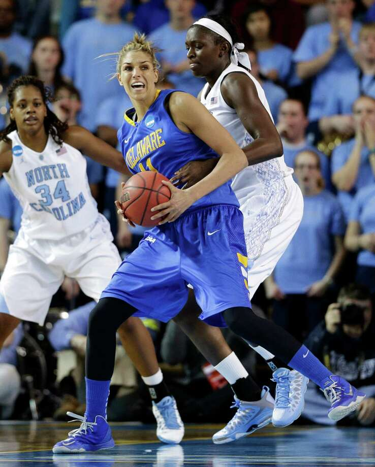 Delaware's Elena Delle Donne, front, drives around North Carolina forward Xylina McDaniel (34) and center Waltiea Rolle during the first half of a second-round game in the women's NCAA college basketball tournament in Newark, Del., Tuesday, March 26, 2013. Photo: Patrick Semansky