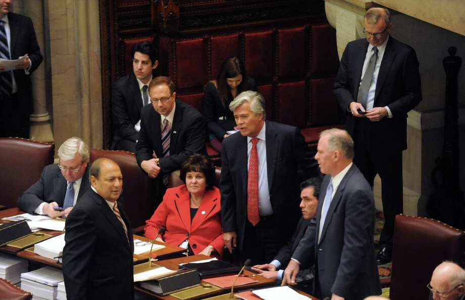 Senate Republican Leader Dean Skelos , center, Senator Kathleen Marchione, seated center, and  on Senator Tom Libous, left, talk on the floor of the New York State Senate chamber at the Capitol on Tuesday March 26, 2013 in Albany, N.Y. (Michael P. Farrell/Times Union) Photo: Michael P. Farrell