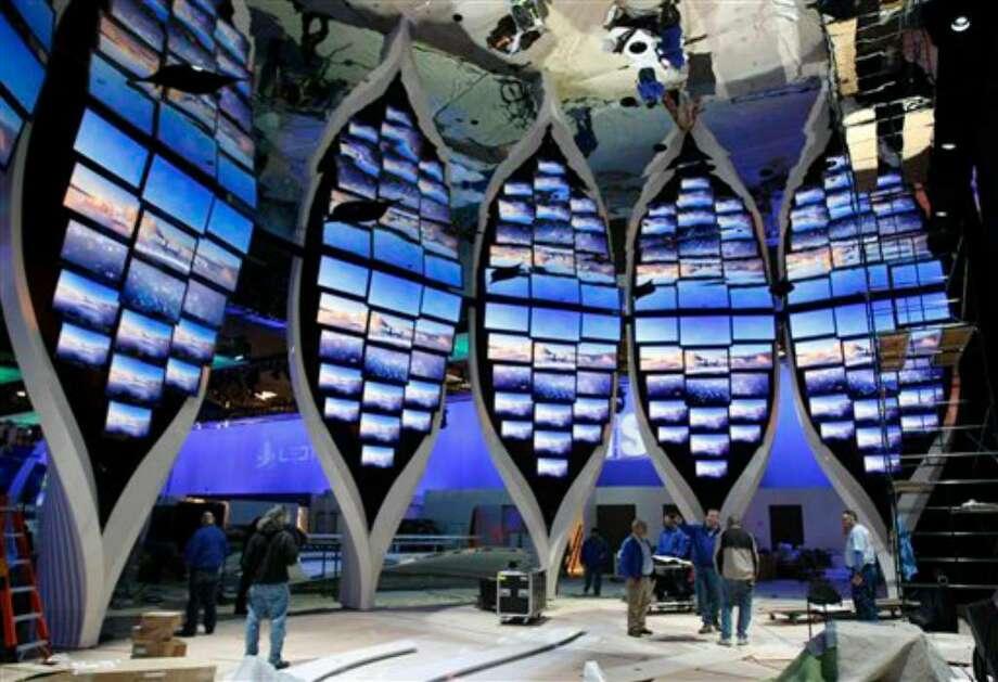 Workers set up the Samsung booth at the Consumer Electronics Show (CES) in Las Vegas, Tuesday, Jan. 5, 2010. The showroom floor opens on Thursday, Jan. 7, 2010. (AP Photo/Paul Sakuma) Photo: Paul Sakuma, AP / AP