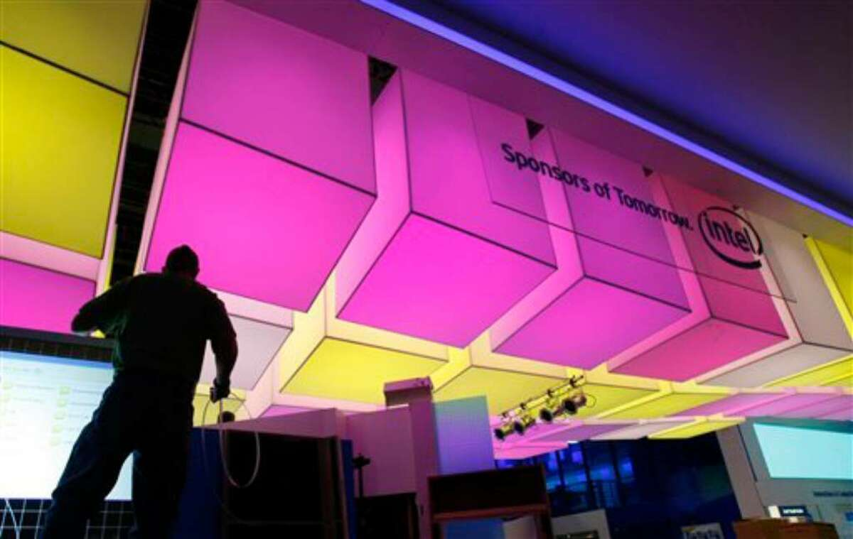 A worker sets up at the Intel Corp. booth at the Consumer Electronics Show (CES) in Las Vegas, Tuesday, Jan. 5, 2010. The showroom floor opens on Thursday, Jan. 7, 2010. (AP Photo/Paul Sakuma)