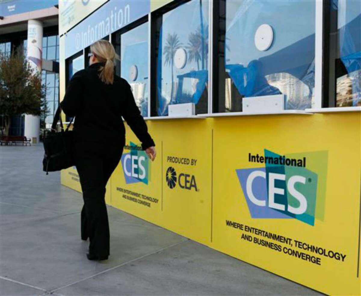 A worker walks by the International Consumer Electronics Show (CES) registration booth in Las Vegas, Monday, Jan. 4, 2010. CES begins Thursday, Jan. 7. (AP Photo/Paul Sakuma)