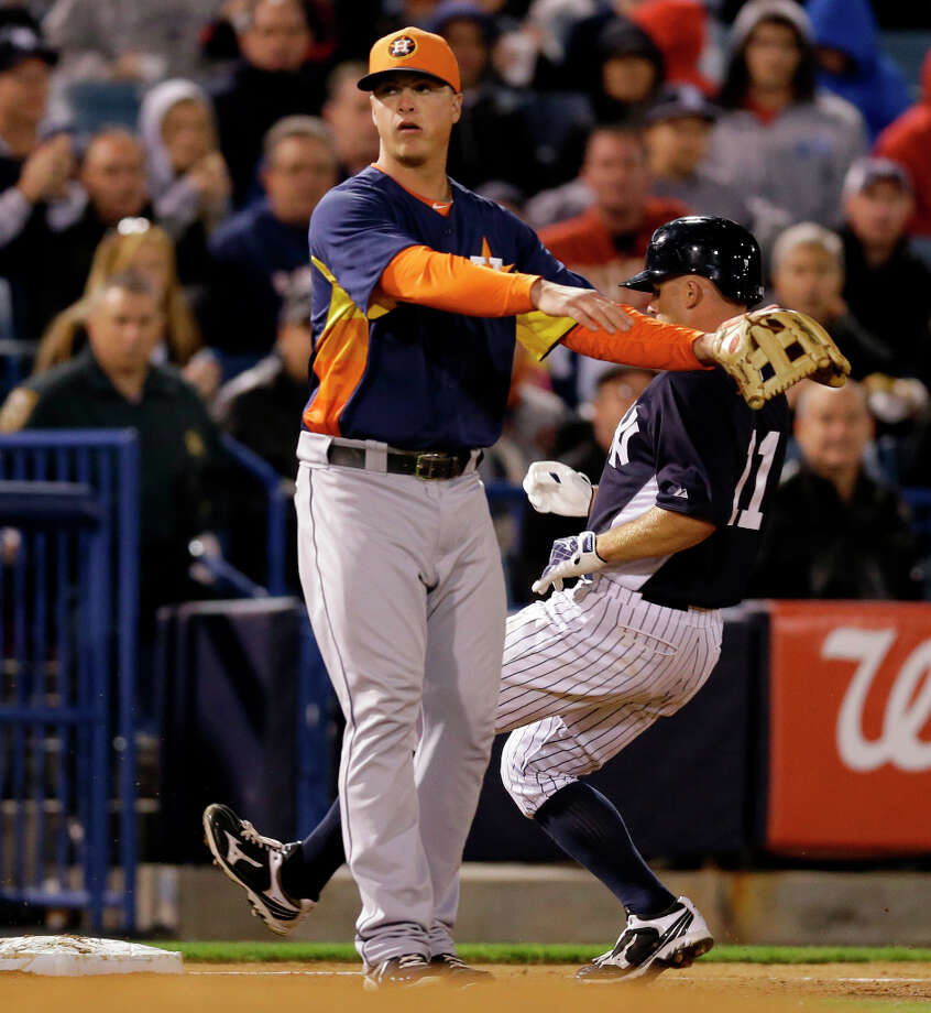 Brett Gardner of the Yankees runs behind Astros third baseman Matt Dominguez after hitting a triple during the sixth inning. Photo: Kathy Willens