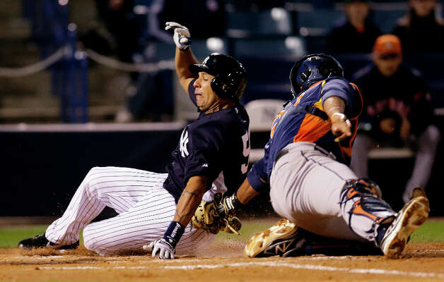 Carlos Corporan of the Astros tags out Juan Rivera of the Yankees during the sixth inning. Photo: Kathy Willens