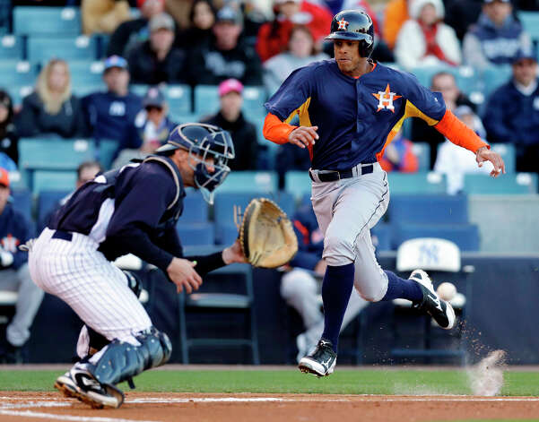 Justin Maxwell of the Astros scores on Chris Corporan's first-inning RBI against the Yankees. Photo: Kathy Willens