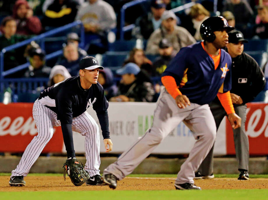 Yankees first baseman Lyle Overbay watches as Jonathan Singleton of the Astros leads off first. Photo: Kathy Willens