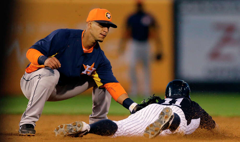 Astros shortstop Ronnie Cedeno tags out Brett Gardner of the Yankees. Photo: Kathy Willens
