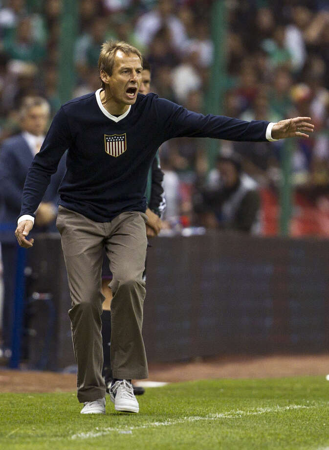 United States coach Jurgen Klinsmann shouts instructions to his players during a World Cup 2014 qualifying match against Mexico. Photo: Christian Palma, Associated Press / AP