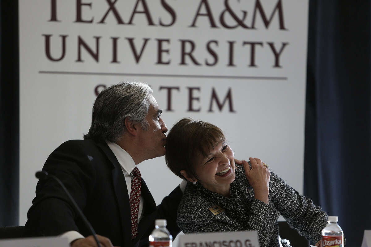 """University of Texas System Chancellor Francisco Cigarroa embraces Maria Hernandez Ferrier, president of Texas A&M University-San Antonio, as they are introduced for a discussion on """"Broadening the Pathway to Higher Education in Texas."""""""