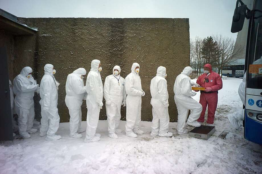 Workers of Dukovany nuclear power plant dressed in radiation protection suits get on a bus during a nuclear accident exercise on March 26, 2013 in Dukovany nuclear power plant, 50km from the city of Brno. MICHAL CIZEK/AFP/Getty Images Photo: Michal Cizek, AFP/Getty Images