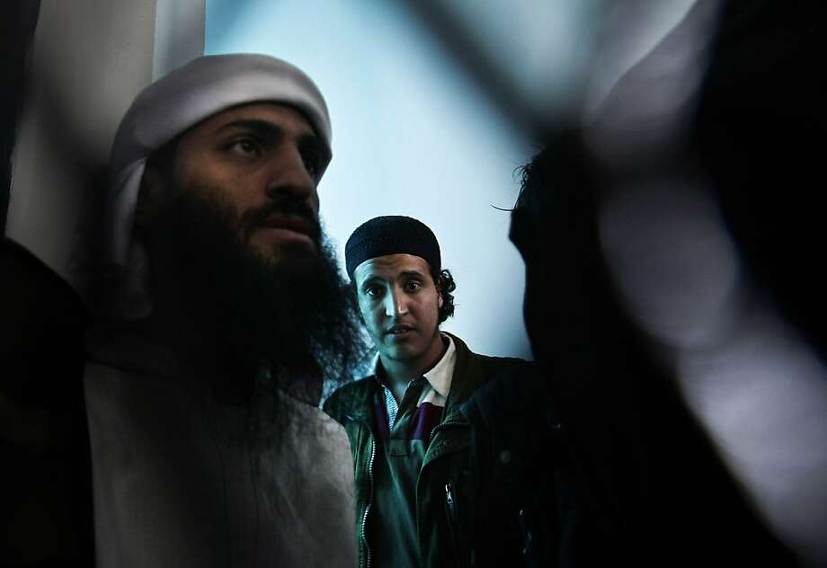Yemeni suspected al-Qaida militants stand behind of bars as they attend their hearing session at a state security court in Sanaa, Yemen, Tuesday, March, 26, 2013. (AP Photo/Hani Mohammed) Photo: Hani Mohammed, Associated Press