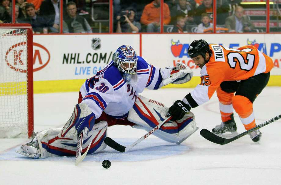 Philadelphia Flyers'  Max Talbot shoots against New York Rangers' Henrik Lundqvist, left, in the second period of an NHL hockey game, Tuesday, March 26, 2013, in Philadelphia. (AP Photo/Tom Mihalek) Photo: Tom Mihalek