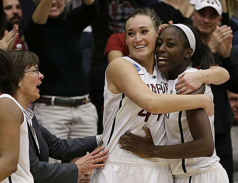 Stanford's Chiney Ogwumike, right, and Joslyn Tinkle embrace as coach Tara VanDerveer, left, celebrates after a second-round game in the women's NCAA college basketball tournament against Michigan on Tuesday, March 26, 2013, in Stanford, Calif. Stanford won the game 73-40. (AP Photo/Ben Margot) Photo: Ben Margot, Associated Press
