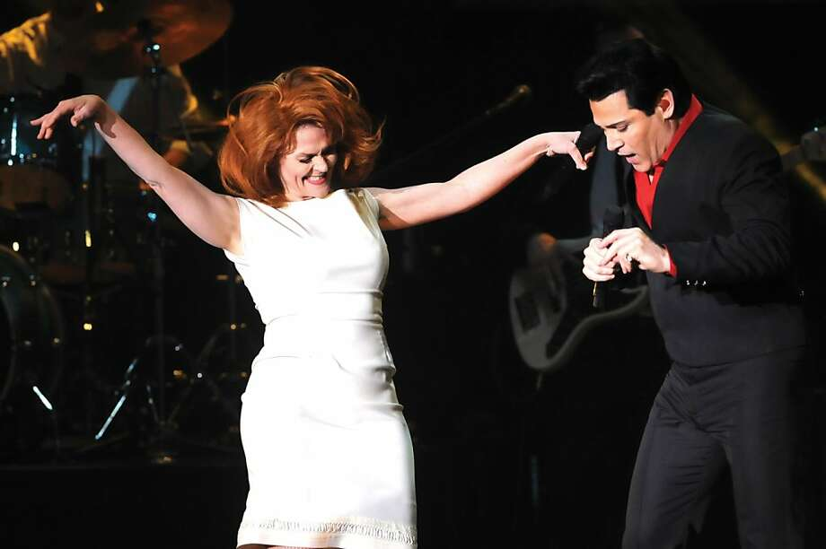 Lori Russo as leading lady Ann-Margaret dances with movie era Elvis played by Kevin Mills as the tribute artists capture the spirit of the King of Rock-N' Roll in the Elvis Lives show at the Paramount Arts Center Tuesday March 26, 2013 in Ashland, Ky. (AP Photo/The Independent, Kevin Goldy) Photo: Kevin Goldy, Associated Press
