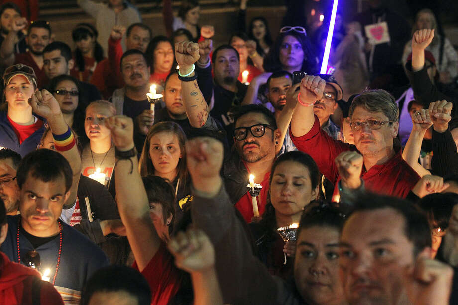 "Participants chant at the Bexar County Courthouse during the ""Light the Way to Justice"" march and candlelight vigil. Photo: Tom Reel / San Antonio Express-News"