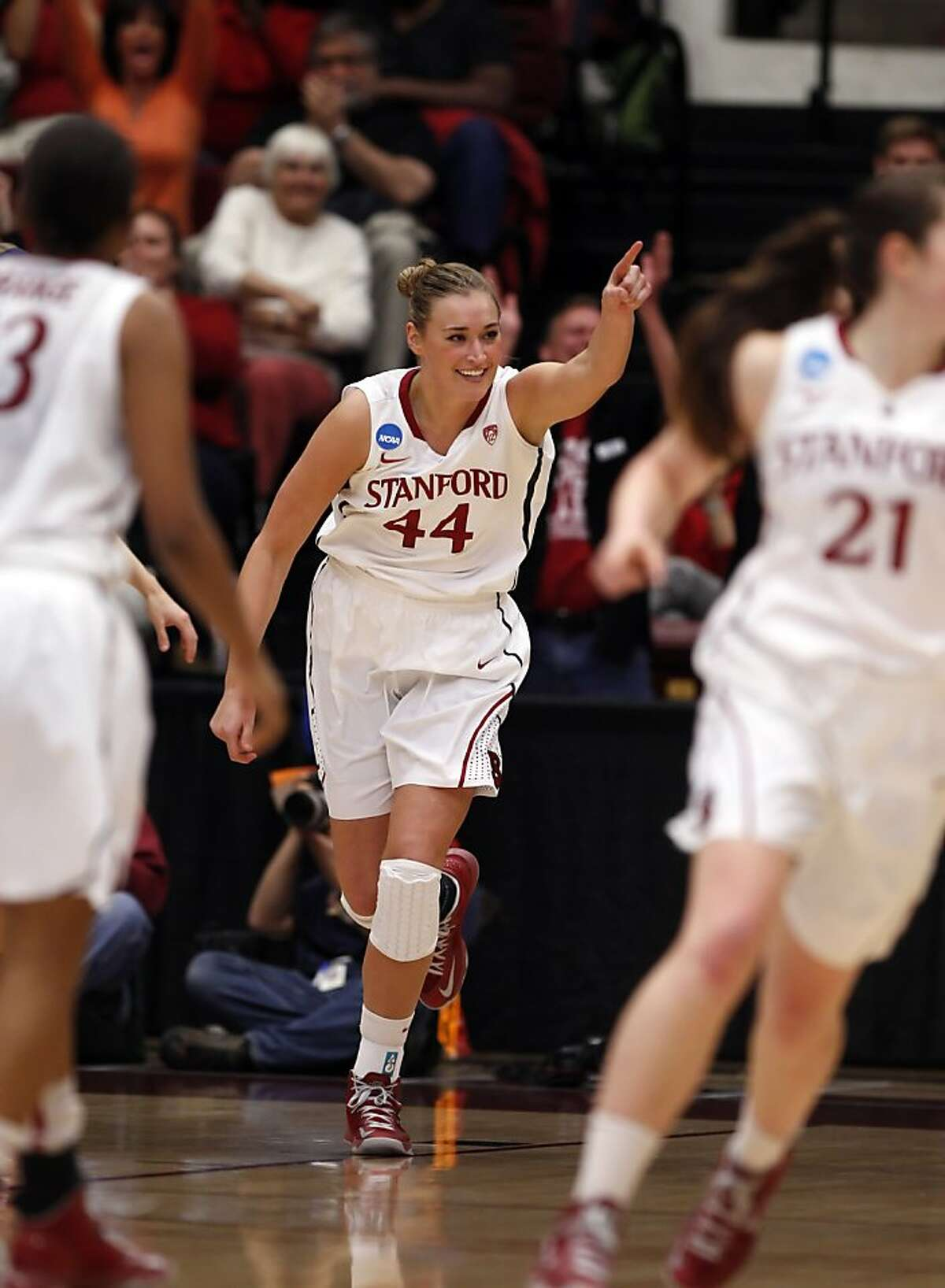 Joslyn Tinkle reacts after scoring in the first half. The Stanford Cardinal played the Michigan Wolverines at Maples Pavilion in Stanford, Calif., on Tuesday, March 26, 2013.