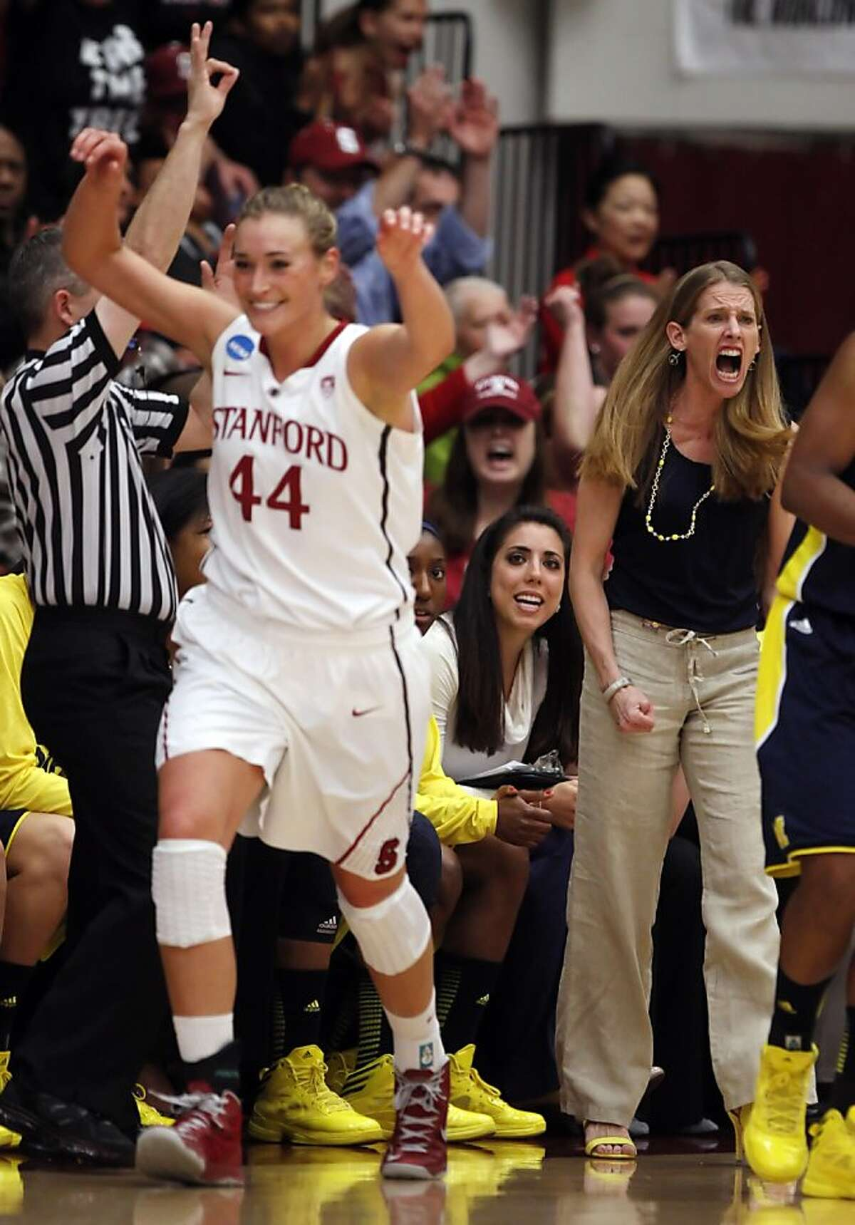 Michigan Head Coach Kim Barnes Arico reacts after Joslyn Tinkle scores a three point shot in the first half. The Stanford Cardinal played the Michigan Wolverines at Maples Pavilion in Stanford, Calif., on Tuesday, March 26, 2013.