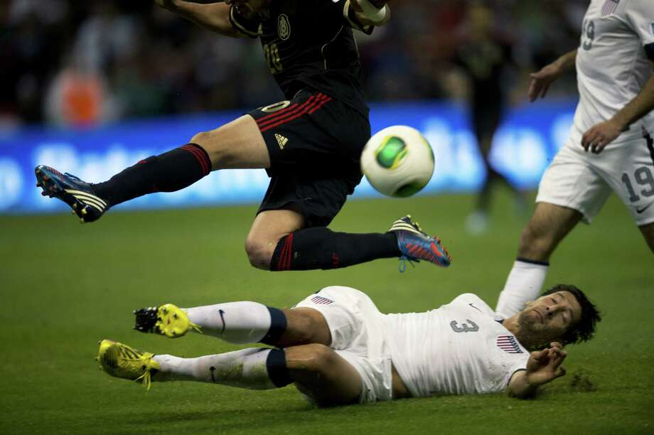 Mexico's Jorge Torres (L) disputes the ball with Omar Gonzalez (R) of the US during their 2014 World Cup qualifying football match at Azteca stadium in Mexico City, on March 26, 2013.  AFP PHOTO/ Yuri CORTEZYURI CORTEZ/AFP/Getty Images Photo: YURI CORTEZ, AFP/Getty Images / YURI CORTEZ